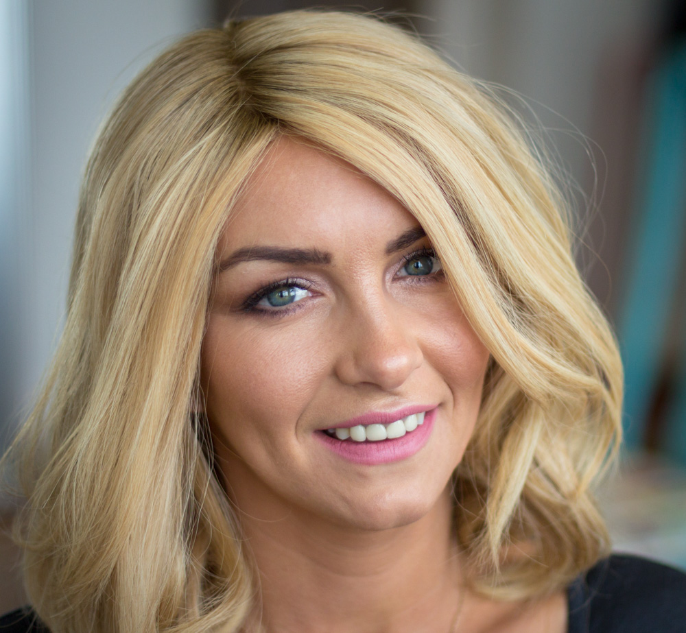 Female Alopecia Areata client with blonde mid length Enhancer system
