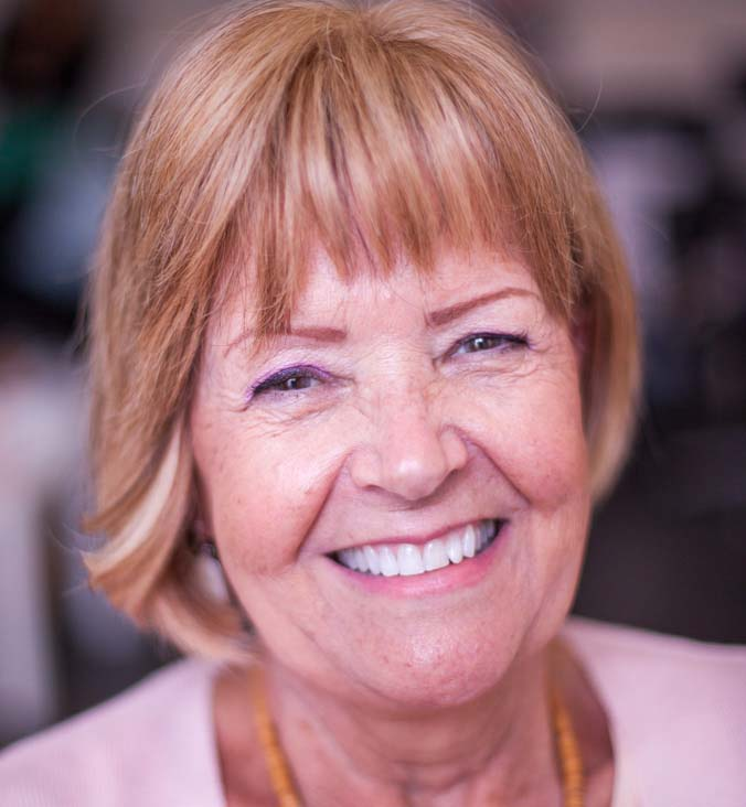 Smiling mature lady after fitting of short bob hair enhancement system