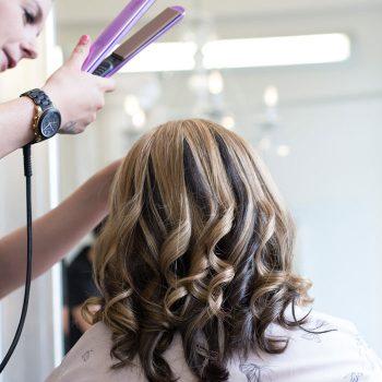 Olivias stylist makes finishing touches