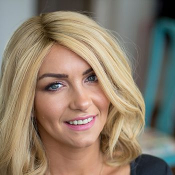 Smiling Client With Alopecia And Blonde Enhancer System Fitted